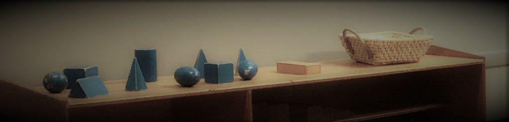 3 dimensional shapes on a shelf